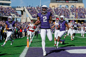 Quarterback Trevone Boykin #2 of the TCU Horned Frogs scores on a 55-yard touchdown reception against the Iowa State Cyclones during the first quarter of the Big 12 college football game at Amon G. Carter Stadium on December 6, 2014 in Fort Worth, Texas.