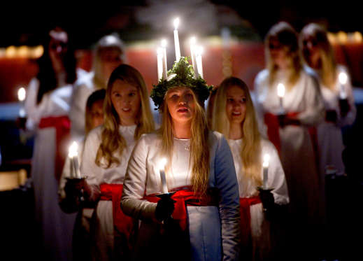 One of the biggest celebrations around Christmas is St. Lucia's Day, which is celebrated on December 13. Young girls dressed in white and a crown of candles takes part in processions singing hymns and giving out saffron buns.