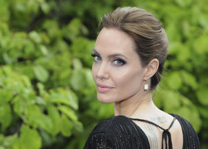 "LONDON, ENGLAND - MAY 08:  Angelina Jolie attends a private reception as costumes and props from Disney's ""Maleficent"" are exhibited in support of Great Ormond Street Hospital at Kensington Palace on May 8, 2014 in London, England."
