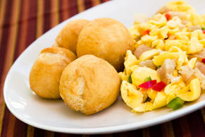 National dish for the Jamaicans, it is prepared with saltfish, boiled ackee, onions and tomatoes sautéed together. It is usually served with vegetable dumplings, fried plantains or rice.