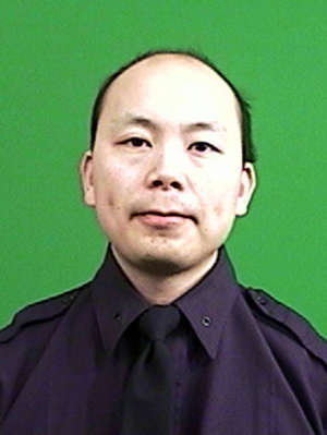 This photo provided by the New York Police Department shows officer Wenjian Liu.