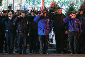 Police officers line the route as vehicles containing the bodies of the two New York Police officers who were shot dead drive by in the Brooklyn borough of New York, December 20, 2014.