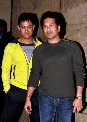 Sachin Tendulkar and Aamir Khan pose for a photograph during a promotional event for the forthcoming Hindi film 'PK' directed by Rajkumar Hirani in Mumbai on December 16, 2014.