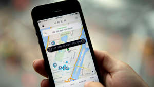 The Uber Technologies Inc. car service application (app) is demonstrated for a photograph on an Apple Inc. iPhone in New York, U.S., on Wednesday, Aug. 6, 2014. For San Francisco-based Uber Technologies Inc. which recently raised $1.2 billion of investors' financing at $17 billion valuation, New York is its biggest by revenue among the 150 cities in which it operates across 42 countries. The Hamptons are a pop-up market for high-end season weekends where the average trip is three time that of an average trip in New York City. Photographer: Victor J. Blue/Bloomberg via Getty Images