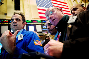 Traders works on the floor of the New York Stock Exchange.