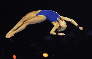 Britain's Tonia Couch dives as she competes in the women's 10 metre platform final during the 19th FINA Diving World Cup at the Oriental Sports Center in Shanghai on July 18, 2014.