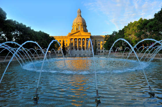 This summer landscape image shows the Legislative building in Edmonton the capitol city in Alberta Canada bathed in a warm morning sunlight.