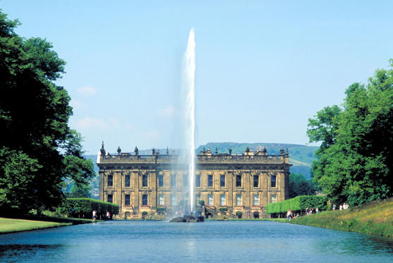 View of Chatsworth House and Lake with Fountain, Bakewell, Derbyshire, England.