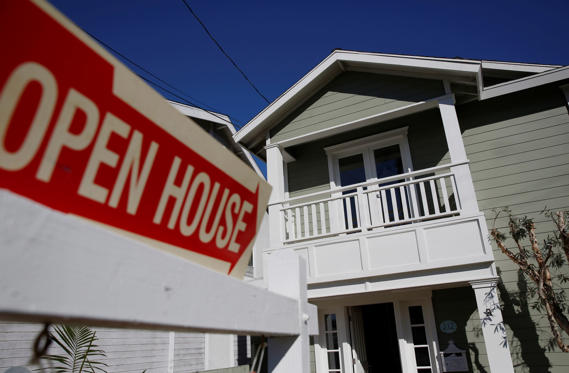 Slide 1 of 28: Open House signage is displayed outside of a home for sale in Redondo Beach, California, U.S., on Saturday, Feb. 14, 2015. The National Association of Realtors is scheduled to release existing home sales figures on Feb. 23. Photographer: Patrick T. Fallon/Bloomberg