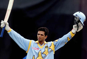 Indian batsman Rahul Dravid raises his bat as he celebrates reaching his century in the World Cup Cricket match against Sri Lanka in Taunton May 26.