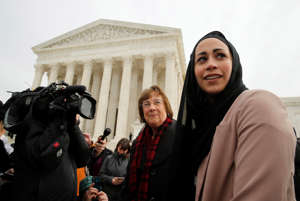 "Samantha Elauf, right, who was denied a sales job at an Abercrombie Kids store in Tulsa in 2008, stands with U.S. Equal Employment Opportunity Commission (EEOC) lead attorney Barbara Seely, center, at the U.S. Supreme Court in Washington, February 25, 2015. The Court on Wednesday considered whether Elauf, who wears a head scarf, or hijab, was required to specifically request a religious accommodation at her job interview at the store in Tulsa in 2008 when she was 17. The company denied Elauf the job on the grounds that wearing the scarf violated its ""look policy"" for members of the sales staff."