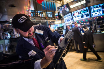 Traders on the floor of the New York Stock Exchange, December 23, 2014.