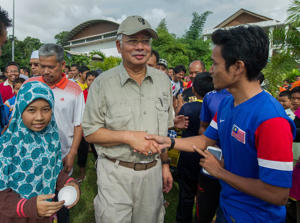 Malaysia's worst floods in decades; PM Razak visits affected areas