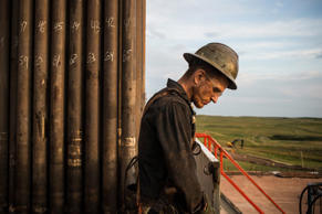 A worker on an oil rig drilling in Watford City, North Dakota.