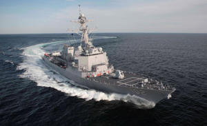 File: This April 2007 photo released by the U.S. Navy shows the guided missile destroyer USS Sampson during a test cruise off the coast of Maine. Sen. John Kerry, D-Mass., announced Monday, June 25, 2007, that the ship will be commissioned during a November ceremony in Boston.