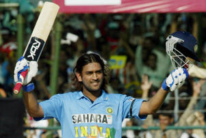 Indian batsman Mahendra Singh Dhoni waves his bat and helmet after he scored a century during the third one-day international match between India and Sri Lanka at the Mansingh Cricket Stadium in Jaipur 31 October 2005. India won by 6 wickets.
