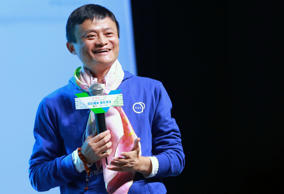 Jack Ma Yun, Chairman of Alibaba Group, laughs during a promotional event for a ...