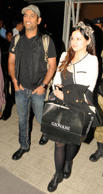 Indian cricket captain Mahendra Singh Dhoni and his wife Sakshi arrive at Birsa Munda Airport in Ranchi on Feb.24, 2014.