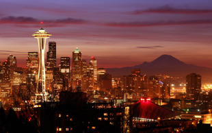 Seattle Sunrise with Space Needle and Mt. Rainier. David Hogan/Flickr RM/Getty Images