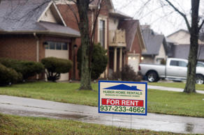 A 'For Rent' sign sits in the front yard of a rental property in Huber Heights, Ohio. Ty Wright/Bloomberg via Getty Images