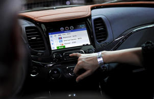An attendee demonstrates the OnStar Corp. 4G LTE dash system on a General Motors...
