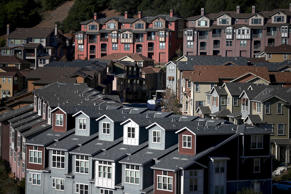 Rows of new homes line a street in a housing development on December 4, 2013 in Oakland, California.