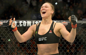 Ronda Rousey reacts after defeating Cat Zingano during their women's bantamweight title bout at UFC 184 at Staples Center on Feb. 28, 2015, in Los Angeles. Rousey won in 14 seconds of the first round.