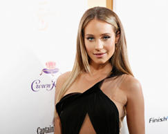 Model Hannah Davis attends as Captain Morgan White Rum and Crown Royal XO raise a glass to the Sports Illustrated Swimsuit 50 Years of Swim Issue at the Sports Illustrated Swimsuit Beach House on February 18, 2014 in New York City.