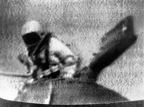 Slide 1 of 22: Soviet cosmonaut Alexey Leonov exits Soviet spacecraft Voskhod 2, becoming the first person to walk in space. Mar. 18, 1965. Image from television. (AP Photo)