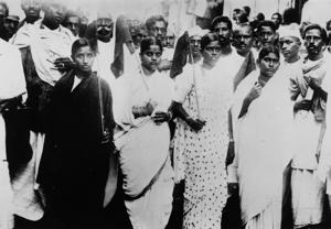November 6, 1945:  Women volunteers carrying flags are parading through the streets of Madras, demonstrating for home rule in India.