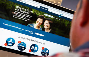 A man looks over the Affordable Care Act signup page on the HealthCare.gov websi...