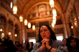 Jan Ali prays during Ash Wednesday Mass at the Cathedral of St. Matthew the Apostle February 18, 2015 in Washington, DC.