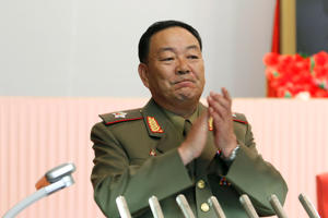 Vice Marshal Hyon Yong Chol applauds during a meeting at the April 25 House of Culture announcing North Korean leader Kim Jong Un's new title of marshal, Wednesday, July 18, 2012, in Pyongyang, North Korea.