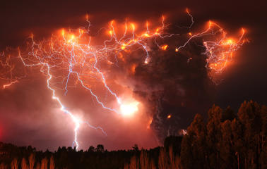 Lightning strikes over the Puyehue volcano, over 500 miles south of Santiago, Chile, Monday June 6, 2011.  Authorities have evacuated about 3,500 people in the nearby area. The volcano was calm on Monday, two days after raining down ash and forcing thousands to flee, although the cloud of soot it had belched out still darkened skies as far away as Argentina