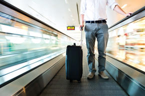 Traveler with a suitcase at the speedwalk. Getty Images