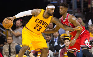 LeBron James of the Cleveland Cavaliers posts up against Jimmy Butler of the Chicago Bulls during game two of their playoff series May 6, 2015, in Cleveland.