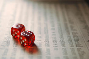 Dice on financial section of newspaper