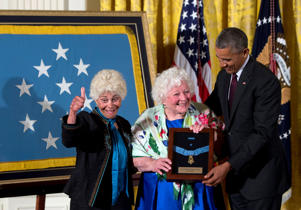 President Barack Obama posthumously bestows the Medal Of Honor for Army Sgt. William Shemin to his daughters Ina Bass, left, and Elsie Shemin-Roth, of suburban St. Louis, during a ceremony in the East Room of the White House in Washington, Tuesday, June 2, 2015.