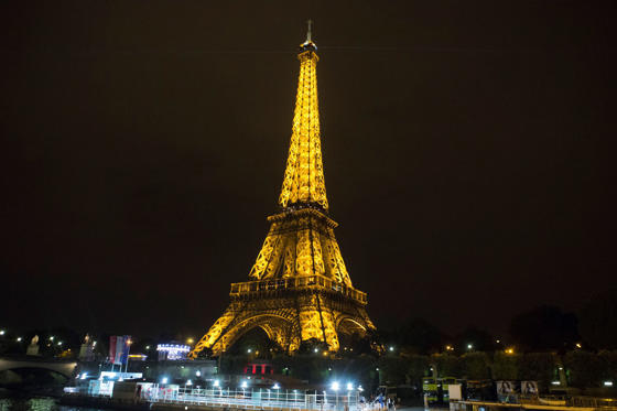 The Eiffel Tower is pictured from the Seine river in Paris, Wednesday night, Sept. 17, 2014. (AP Photo/Jacques Brinon)