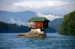 A house built on a rock on the river Drina is seen near the western Serbian town of Bajina Basta, about 160km (99 miles) from the capital Belgrade May 22, 2013. The house was built in 1968 by a group of young men who decided that the rock on the river was an ideal place for a tiny shelter, according to the house's co-owner, who was among those involved in its construction. REUTERS/Marko Djurica (SERBIA - Tags: ENVIRONMENT SOCIETY TRAVEL TPX IMAGES OF THE DAY)