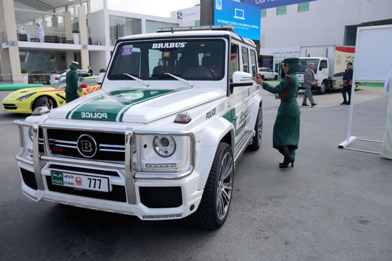 DUBAI, UNITED ARAB EMIRATES - NOVEMBER 18:  A Female Emerati police officer locks her Mercedes Benz Brabus 4x4 supercar during the Dubai Airshow on November 18, 2013 in Dubai, United Arab Emirates. The Dubai Air Show is the premier Middle East air show for trade and business delegates organized by F&E Aerospace.  (Photo by Christopher Furlong/Getty Images)