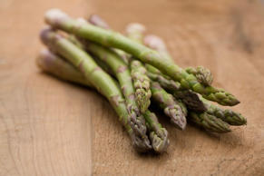 Asparagus on table. VStock/Tetra Images/Corbis