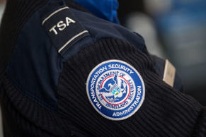 A Transportation Security Administration (TSA) officer works at a security check...