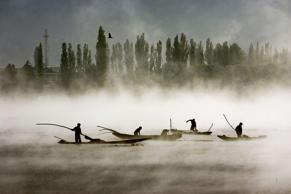n Dal Lake clearing weeds early in the morning. Srinagar, Kashmir, India. Famou