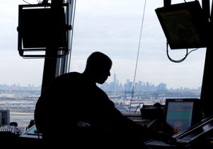 In this May 21, 2015 file photo, an air traffic controller works in the tower at Newark Liberty International Airport in Newark, N.J.
