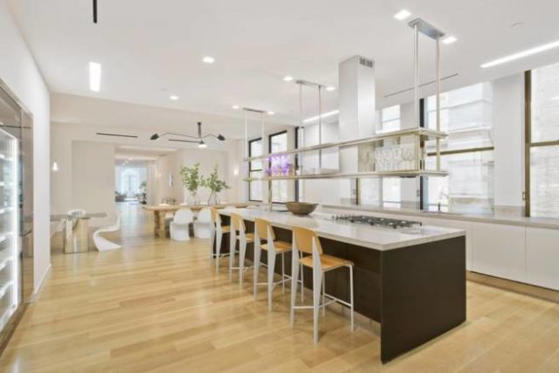 Jennifer Lopez's new $22 million penthouse located in Manhattan's NoMad neighborhood features an open-plan kitchen with sleek and modern details.