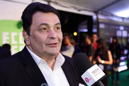 File: Indian actor Rishi Kapoor poses at the IIFA green carpet event at the 2012 International India Film Academy Awards at the Singapore Indoor Stadium on June 9, 2012 in Singapore.