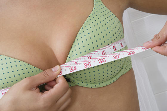 Slide 1 of 22: Woman measuring breasts. moodboard/Getty Images