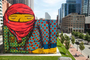 "A wall mural painted by Brazilian graffiti artists Os Gemeos is seen in Boston August 8, 2012. The work has created a stir after viewers posted comments on a local TV channel's Facebook page, claiming it looked ""like a terrorist"" and urging for it to be removed, according to news reports."