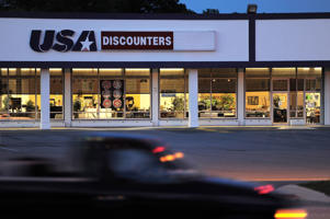 A location of USA Discounters is seen on Tuesday June 24, 2014 in Virginia Beach, VA. The store offers a variety of goods including home furniture and electronics.
